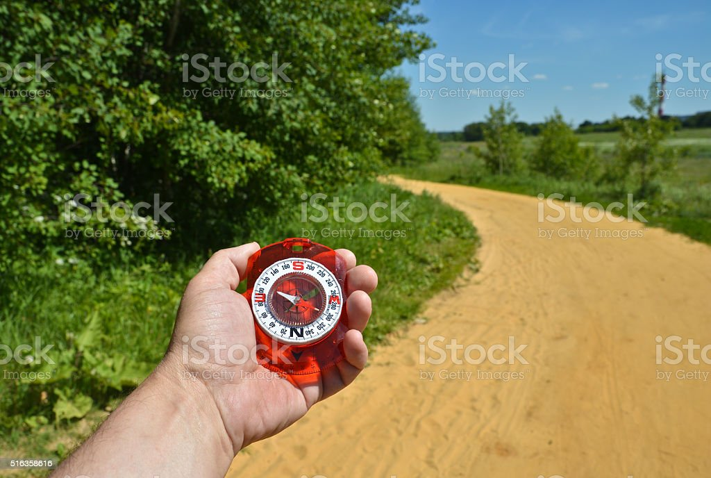 Compass in hand. stock photo