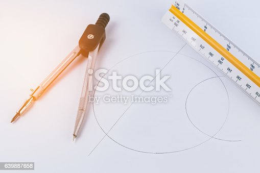 istock Compass instrument with ruler on paper work 639887658