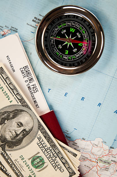 Compass money and passport with boarding pass picture id177121788?b=1&k=6&m=177121788&s=612x612&w=0&h=0pu ftpeu9bimu6texk6mi4oxsg5raapjrwmeaklq48=