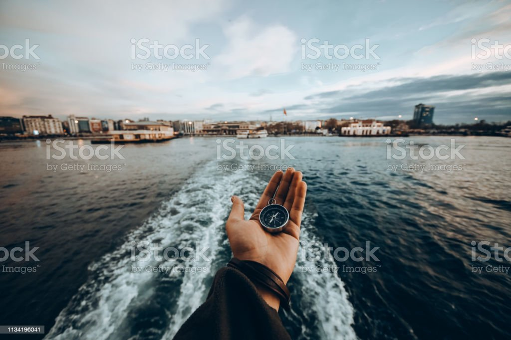 Compass, navigational compass, travel compass, lost compass, stock photo