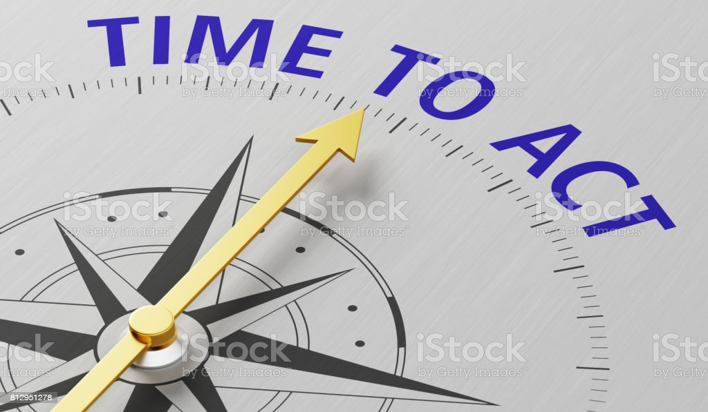 Compass needle pointing to the text Time to act stock photo