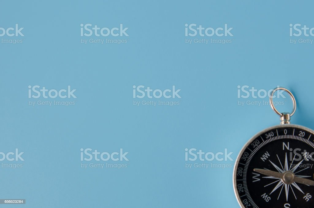 Compass on a blue background stock photo
