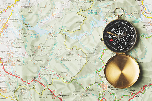 compass on a map background - road map stock photos and pictures