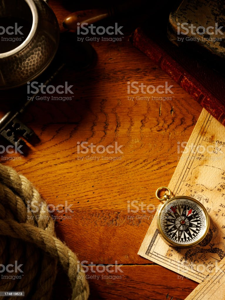 Compass on a Old Oak Table stock photo