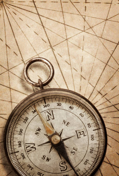 compass on an old map - west direction stock pictures, royalty-free photos & images