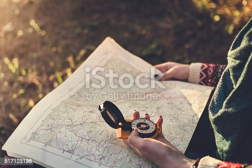 istock Compass on background of map in the forest 517123198