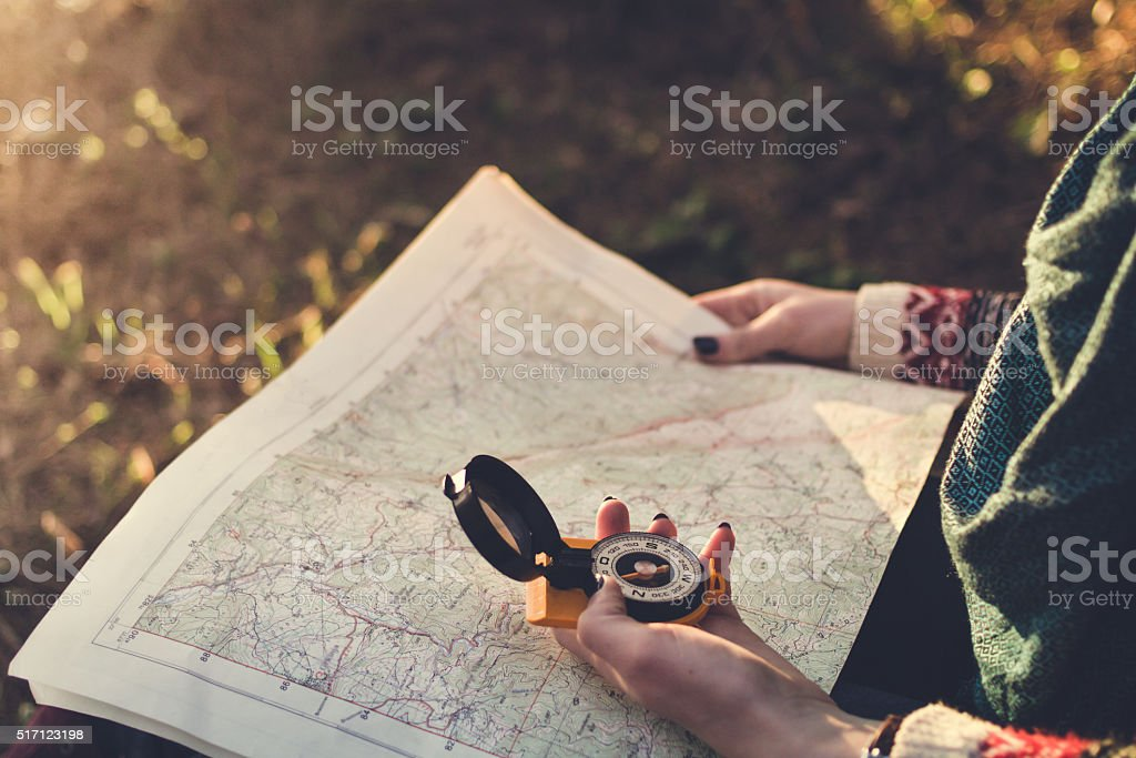 Compass on background of map in the forest bildbanksfoto