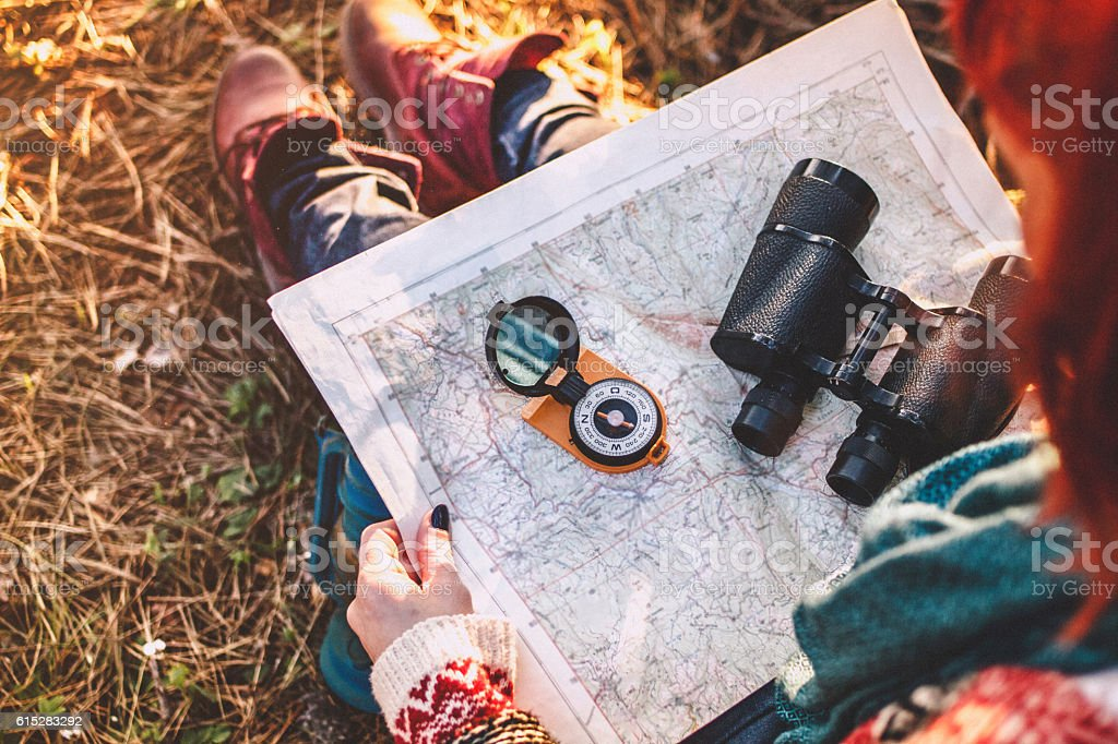 Compass on background of map in the forest stock photo