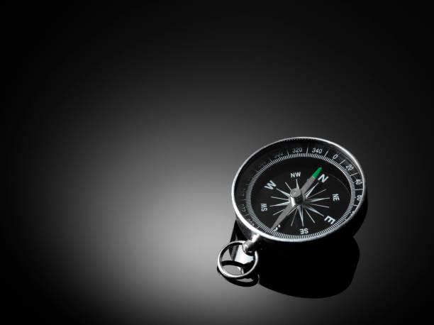 Compass on black background stock photo