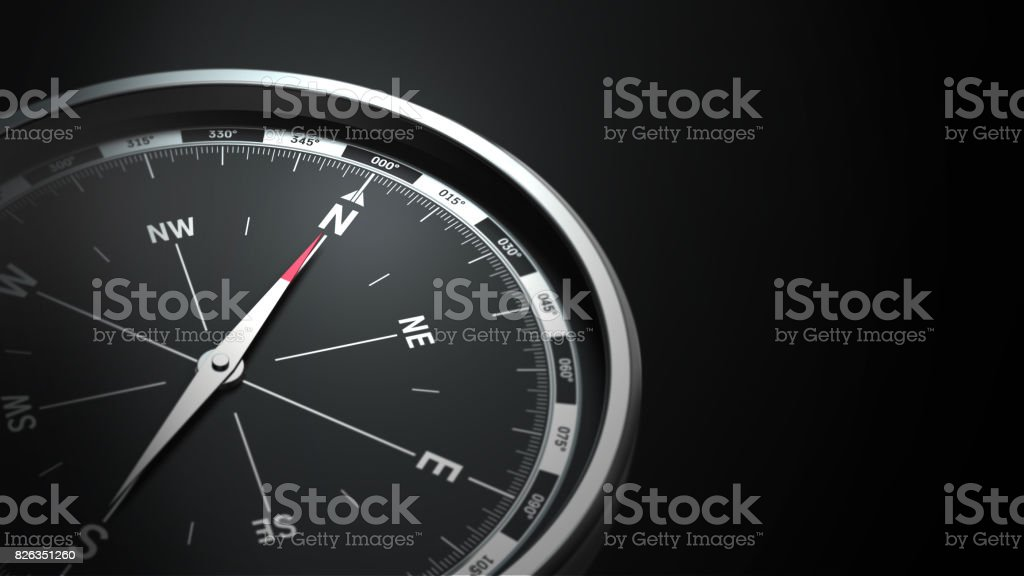 compass on black background stock photo