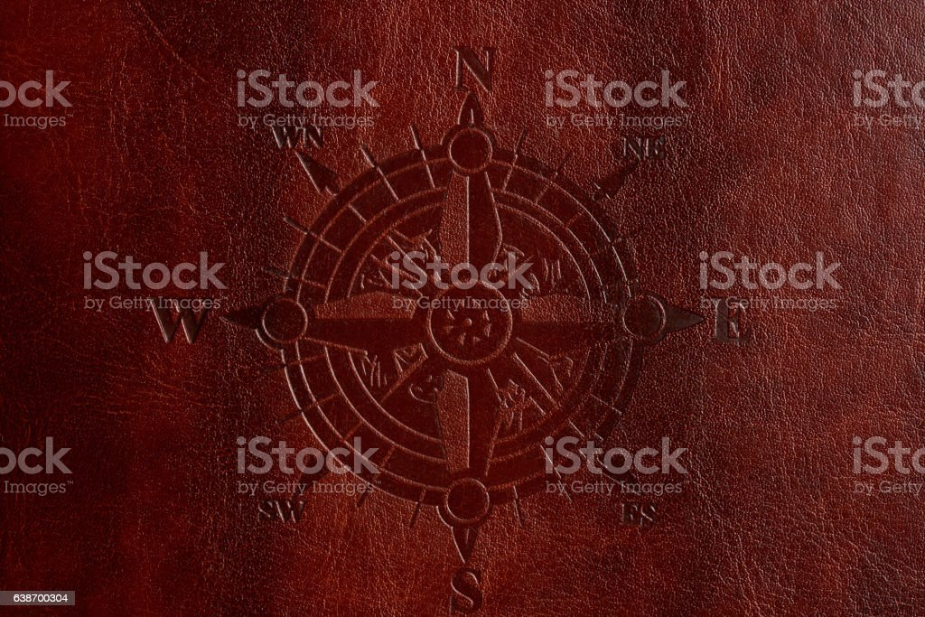 Compass on brown leather stock photo