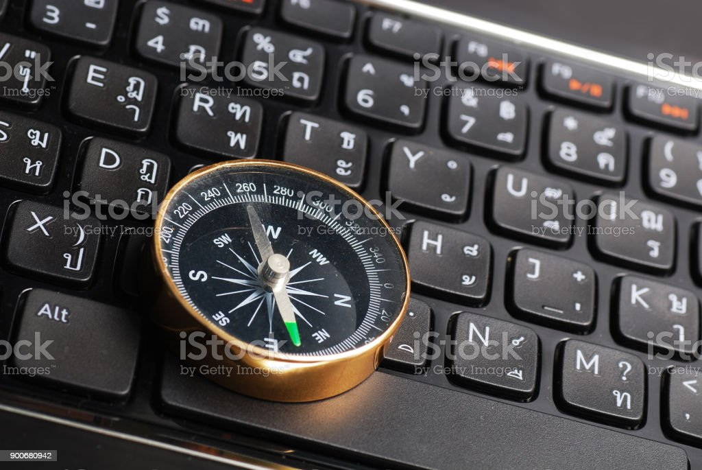 Compass On Computer Keyboard Stock Photo More Pictures Of Arrow