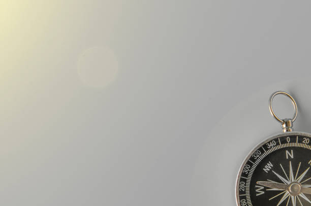 compass on gray background - west direction stock pictures, royalty-free photos & images