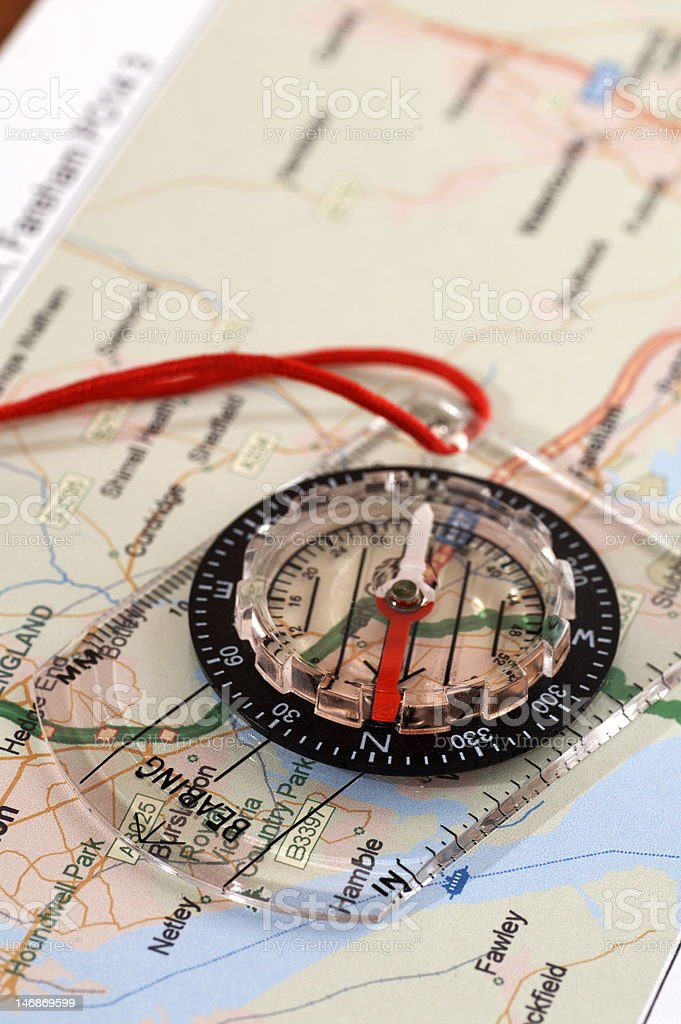 Compass on map showing North royalty-free stock photo