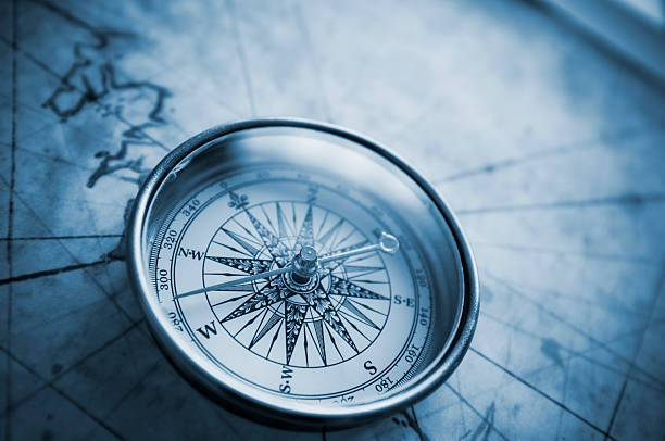 compass on old map - navigational compass stock photos and pictures
