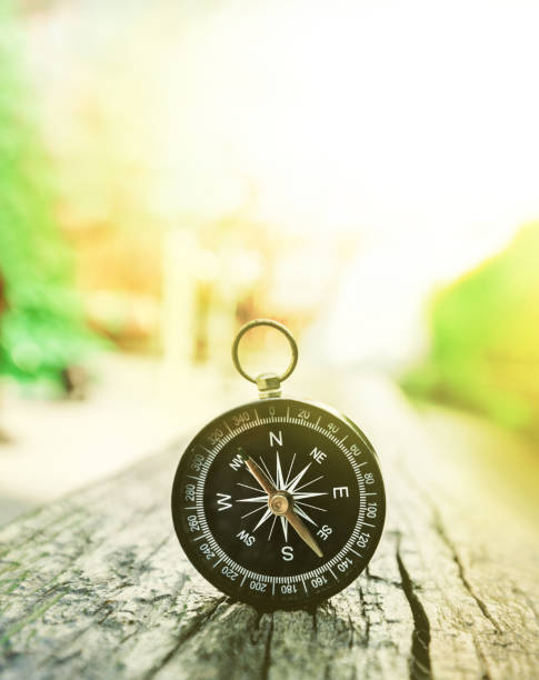 Compass on Old Wood in Sun Light Effice, Looking for a Better Future Concep stock photo