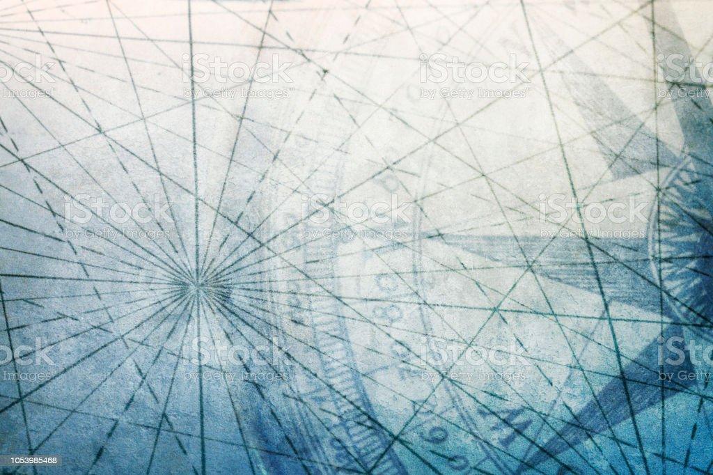 Boussole sur la carte du vieux monde avec des lignes de navigation sur la Surface texturée - Photo