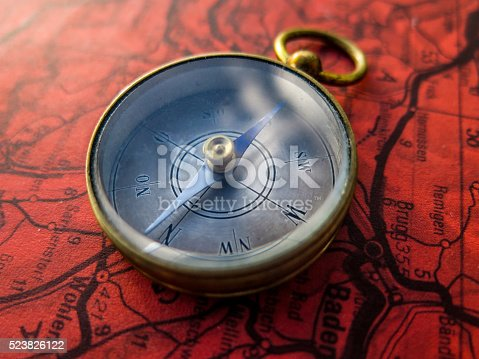 537607438istockphoto Compass on red roadmap 523826122