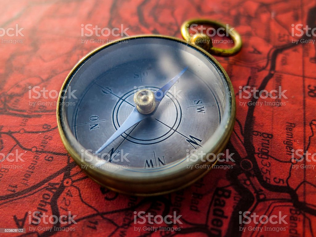 Compass on red roadmap stock photo