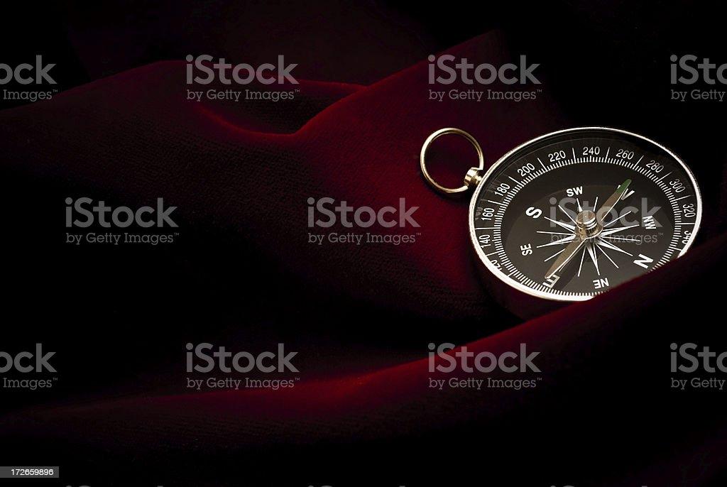 Compass on red velvet stock photo