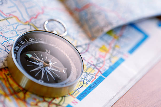 compass on road map - road map stock photos and pictures