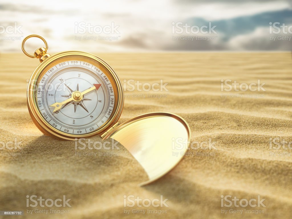Compass on sea sand. Travel destination and navigation concept. stock photo