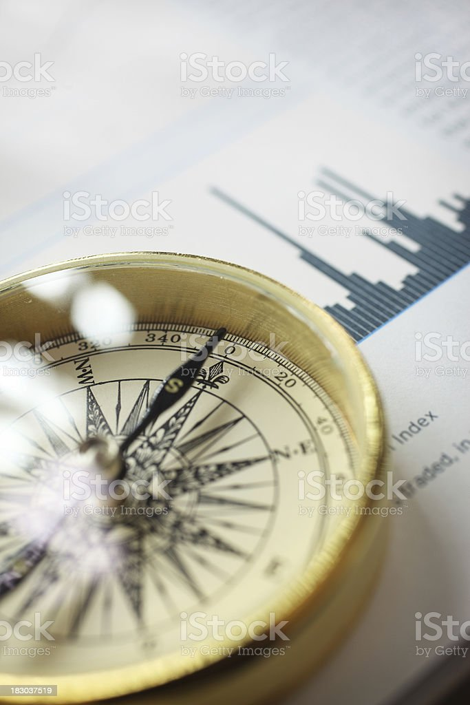 Compass on Stock Market Data Chart royalty-free stock photo