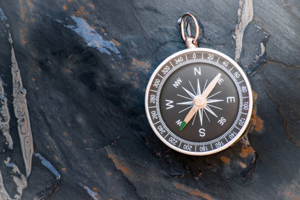 compass on stone board background. Using wallpaper or background travel or navigator image stock photo