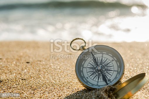 537607438istockphoto Compass on the beach 637772400