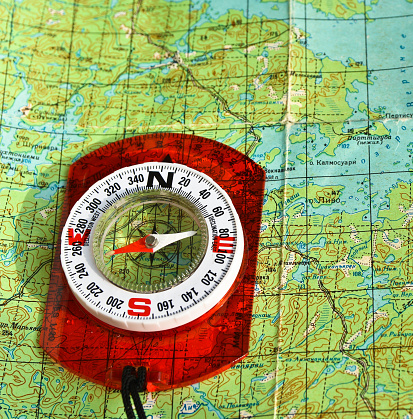 97623256 istock photo compass on the map. 470997412