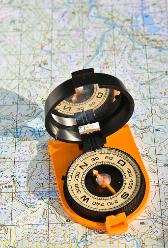97623256 istock photo compass on the map. 470997420