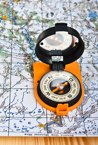 97623256 istock photo compass on the map. 479377942
