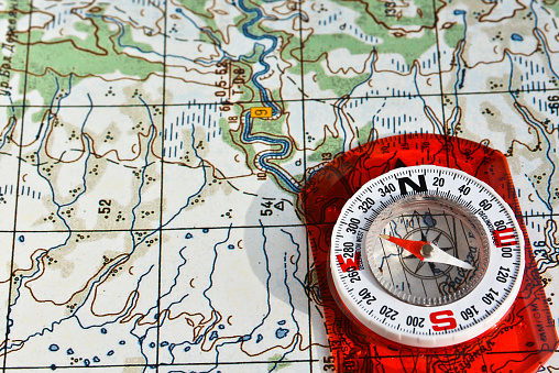 97623256 istock photo compass on the map. 479377946