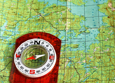 97623256 istock photo compass on the map. 479377948