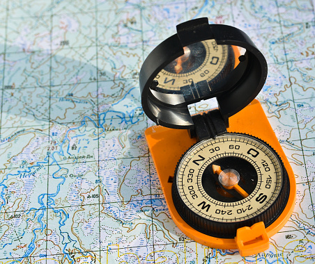 97623256 istock photo compass on the map. 479377950