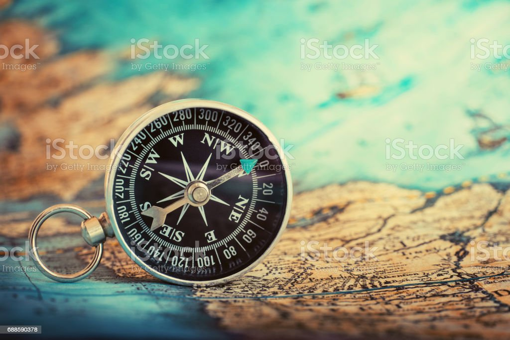 Compass on the map. stock photo