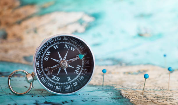 compass on the map - travel imagens e fotografias de stock