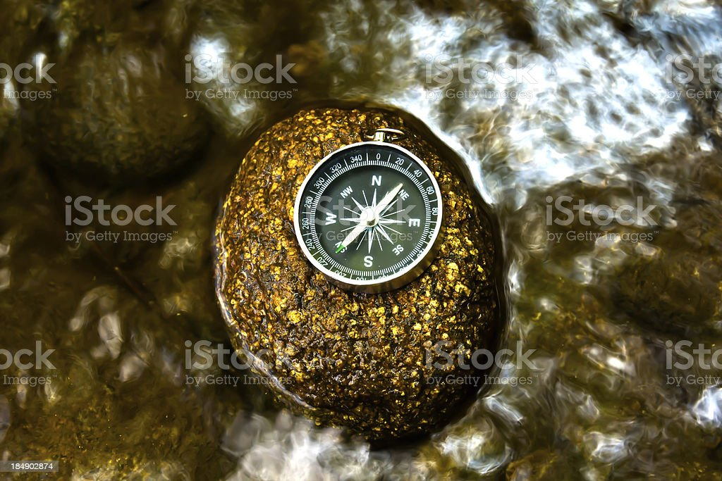 compass on the rock royalty-free stock photo