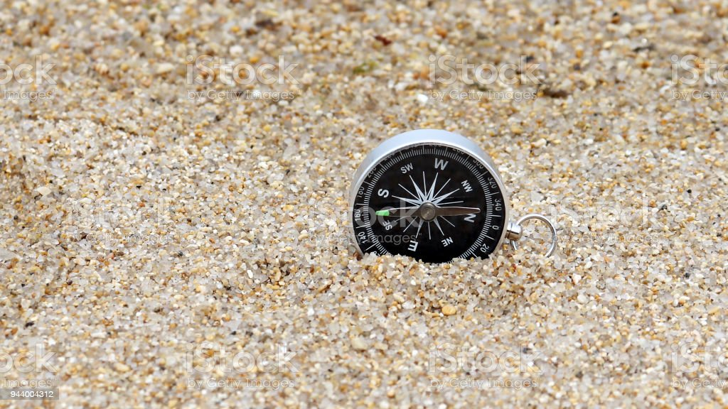 A compass on the sand. stock photo