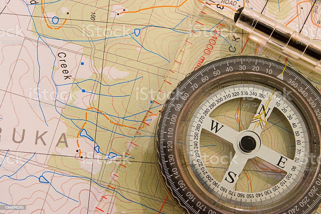 Compass on the top of map #2 royalty-free stock photo