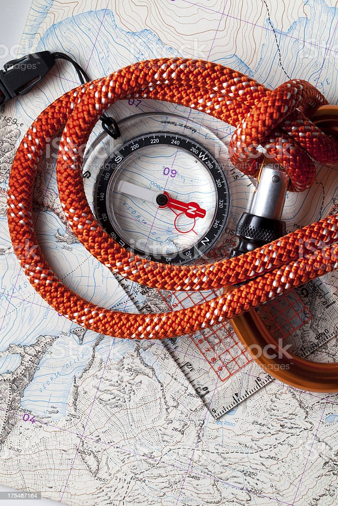 Compass on topographic map with rope climbing royalty-free stock photo