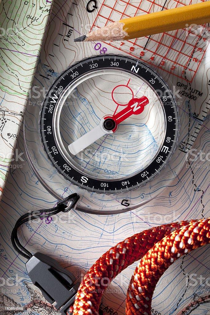 Compass on topographic maps. stock photo