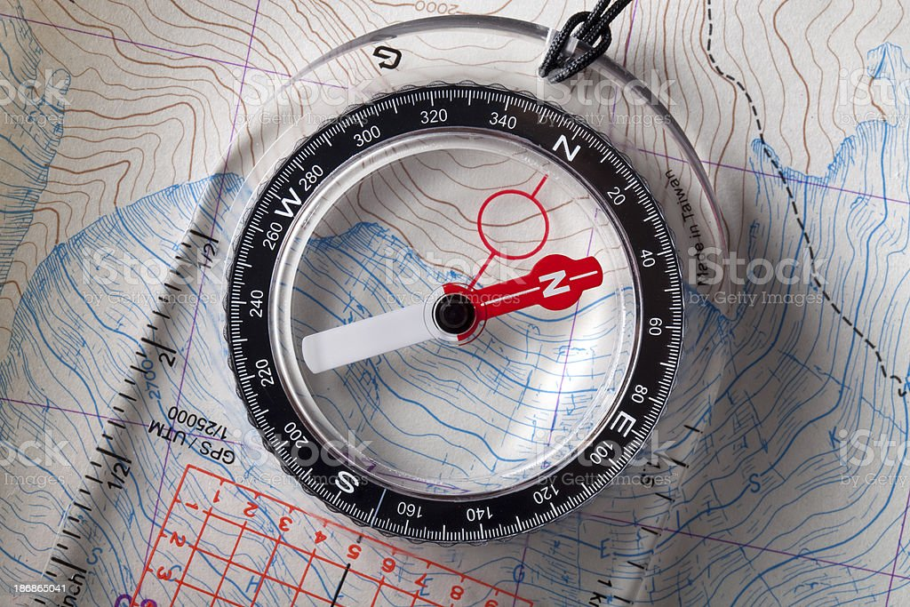 Compass on topographic maps. stock photo