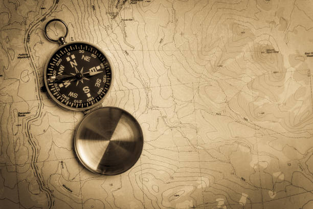 Compass on topographical map stock photo