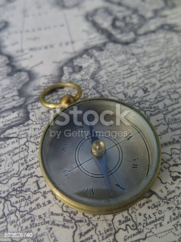 537607438istockphoto Compass on vintage map 523826740