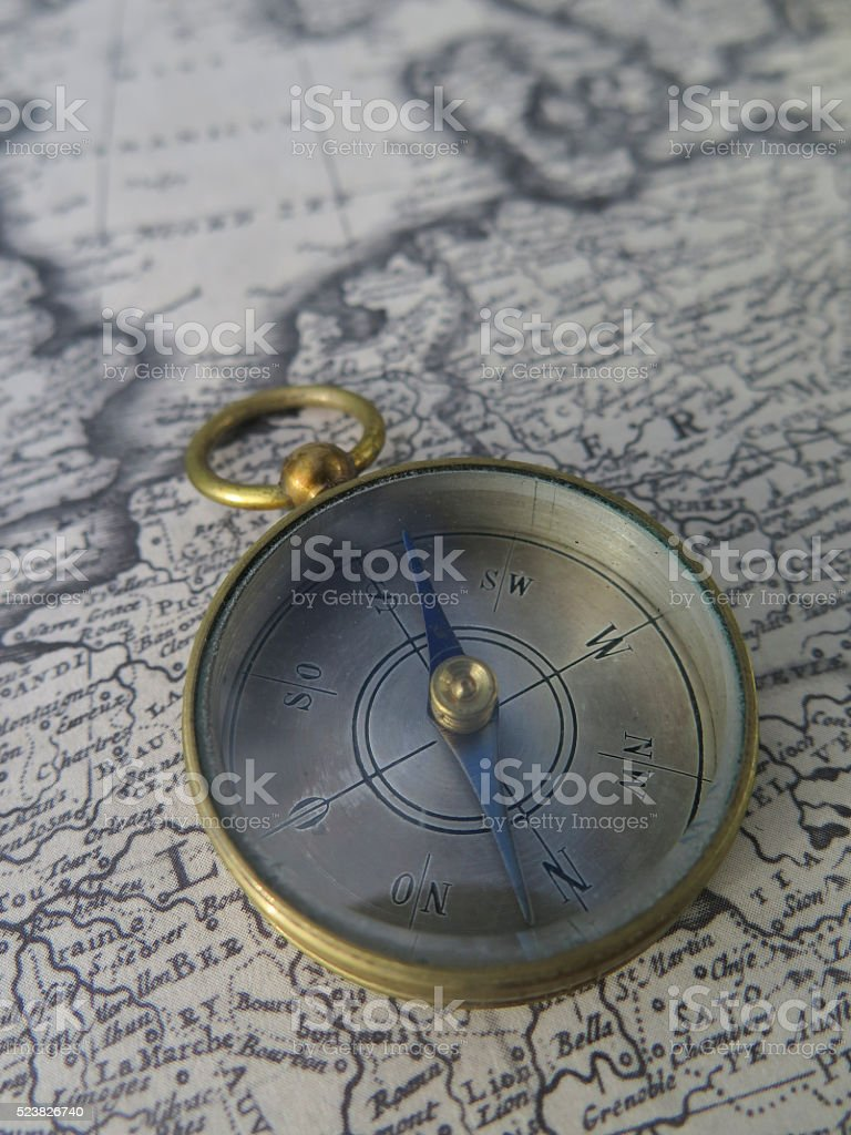 Compass on vintage map stock photo