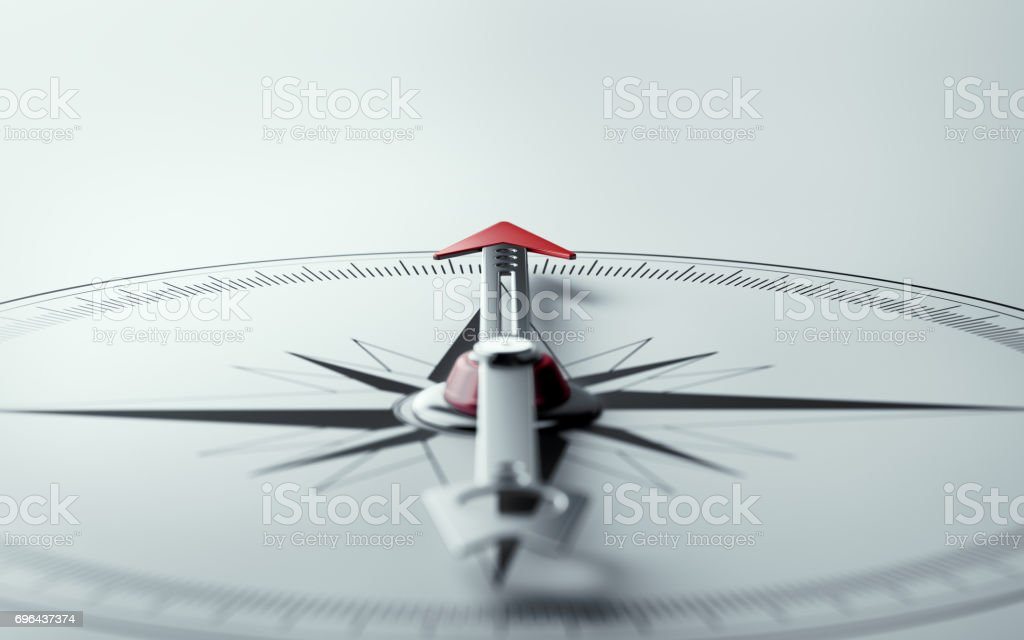 Compass on White Background with Selective Focus stock photo