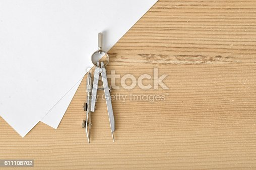 istock Compass on white paper in top view with copy space 611108702