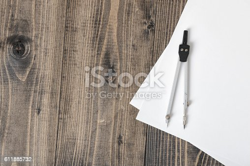 613651130 istock photo Compass on white paper in top view with copy space 611885732