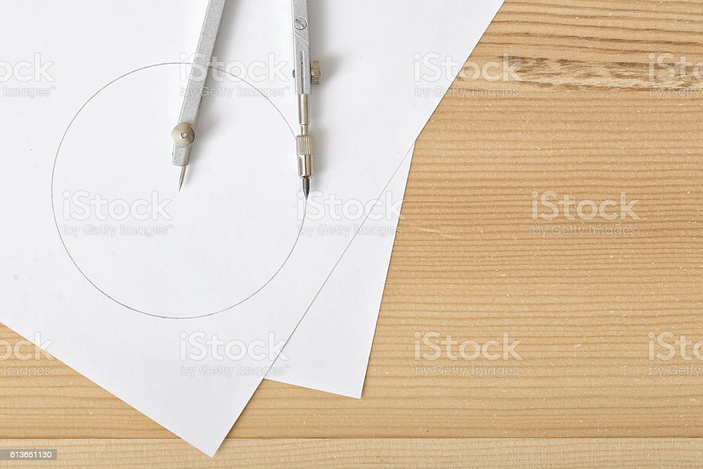 Compass on white paper in top view with copy space stock photo